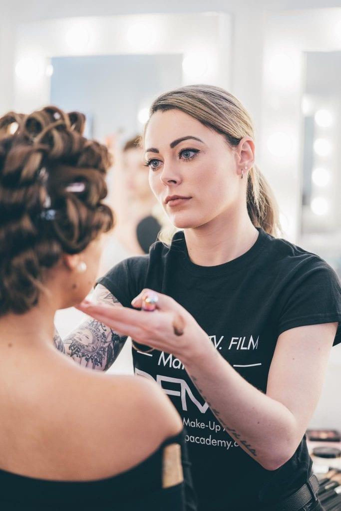 DFMA Student applying make up
