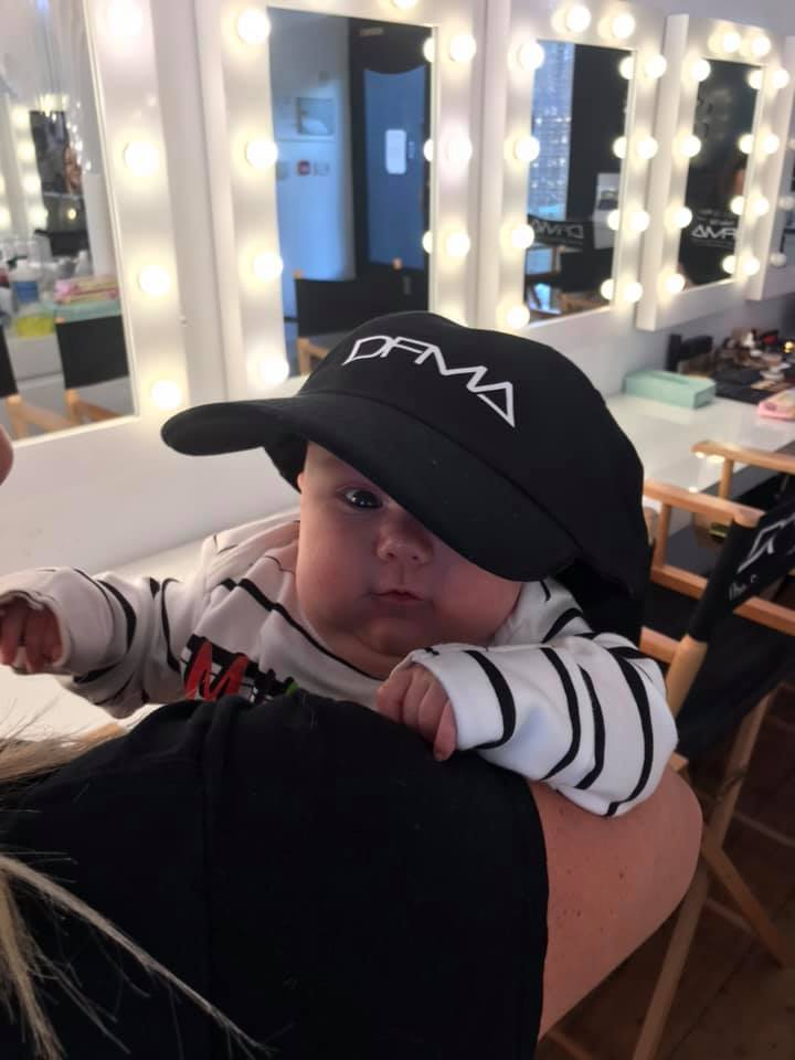 Baby in DFMA hat